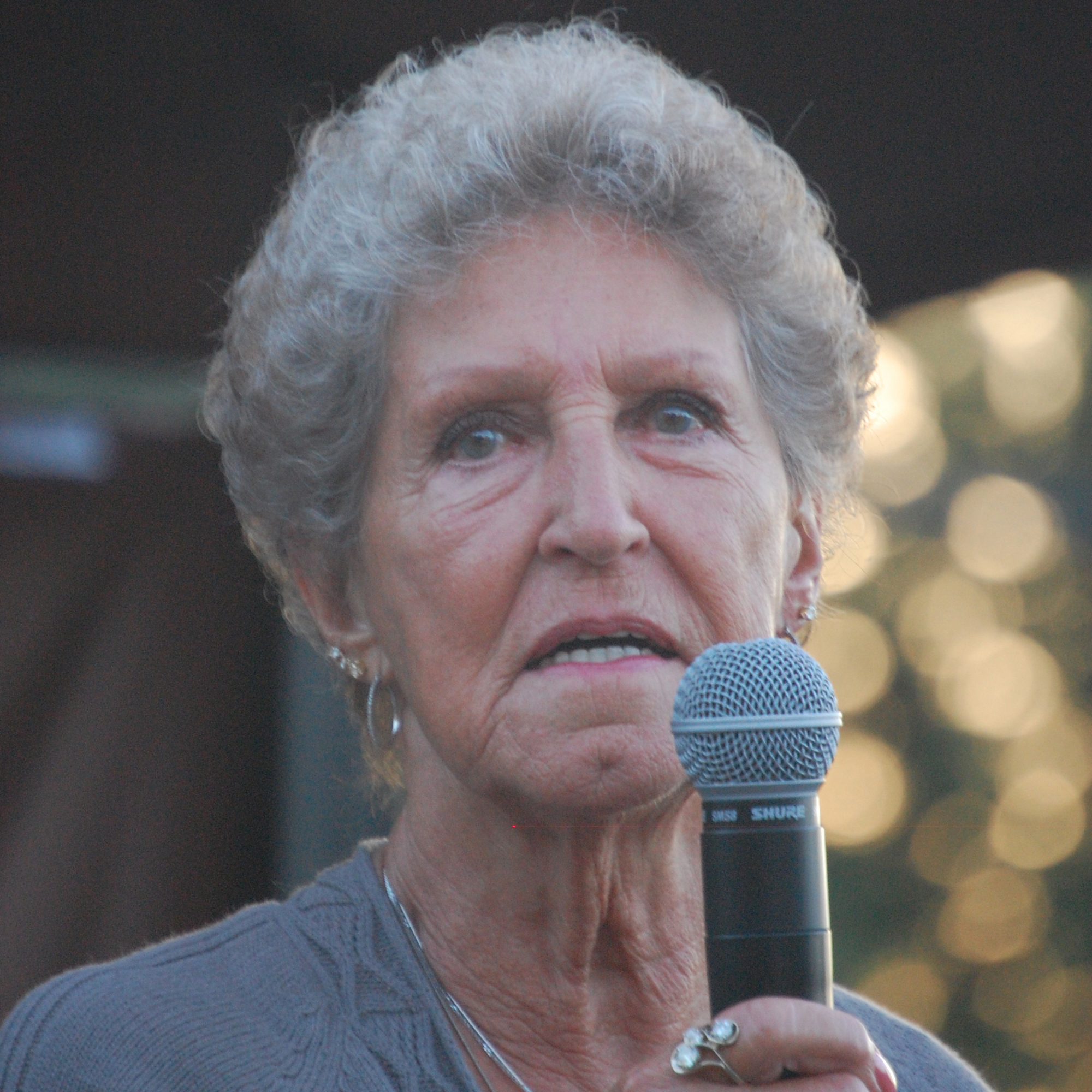 Nan Busby speaking at a graduation ceremony.